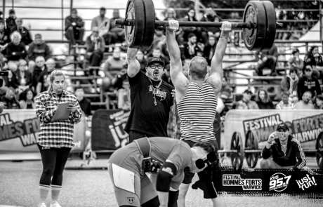 Roman doing an axle press at a competition